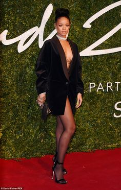 Rule breaker! Rihanna showed both her chest and legs in her daring ensemble of just a tuxedo jacket as she arrived at the 2014 British Fashion Awards at the London Coliseum on Monday night
