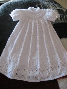Cabled Yoke Christening Gown for a baby knitting pattern designed by Judy Lamb. Find the free pattern here: link A feather and fan stitch gives a light texture to this baby blanket knit in two colors of Bernat Baby Sport. More Patterns Like This! Baby Knitting Patterns, Knitting For Kids, Easy Crochet Patterns, Crochet For Kids, Baby Patterns, Free Knitting, Dress Patterns, Knit Baby Dress, Knitted Baby Clothes