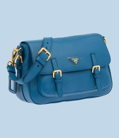 Prada Latest collection handbag. A superb collection. The handbag seems strong and well all the metal accessories are gold plated. Amazing design. You will find a logo on the inside too. This is a hand and shoulder bag so carrying it is easy. It packs in quite a punch with a label holder, strong stitching, buckles and a zipper pocket inside. The color is what I love. It is so vibrant. This one is for the power dresser with sense of fashion.