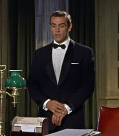 Sean Connery as James Bond in Dr No, in a dinner suit by Anthony Sinclair. A classic, truly. And it was actually a nod to the style that Ian Fleming himself wore...most notably the gauntlet cuffs -- which were a favourite detail of Fleming's -- on the dinner jacket.