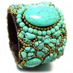 Turquoise stone cord cuff bracelet.