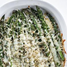 This baked cheesy asparagus recipe needs just 5 ingredients and is ready in 20 minutes. The perfect easy, healthy side dish!
