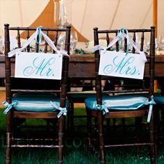 "Reception Chair Signs: ""Mr."" and ""Mrs."" signs marked the couple's seats."