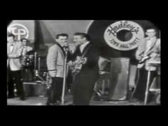 1958  - a  huge hit - 'Summertime Blues -  by Eddie Cochran - This was covered by more than I can list...the Who had a huge hit with it and still play it today in concert.