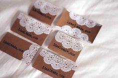 Handmade business cards:: Simple with just website. Doily and brown paper