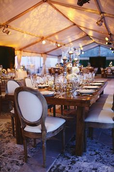 Romantic wedding reception décor with white flowers | @aglasshaus | Brides.com