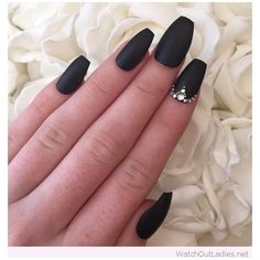 Matte black nails with diamonds ❤ liked on Polyvore featuring beauty products and nail care