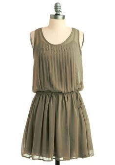 love the olive green and pleats