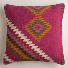 Crafted in India of 100% wool with a removable insert, our warm and cozy pillow features a bold Southwestern design on a vibrant purple-pink field.