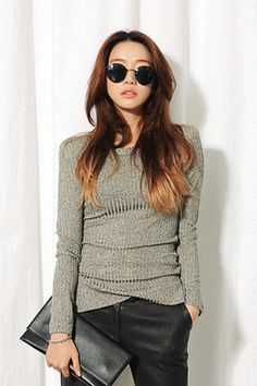 Shoulder Padded Slim Ribbed T-ShirtStand out in this shoulder padded shirt. The shoulder pads add structure and form to your overall appearance. With a round neckline, long sleeves, ribbed details all-over, and an overall slim fit. Wear it as a layering piece under coats or jackets, or by itself with skinny pants or cropped pants.