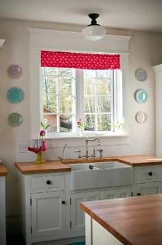 Canadian Cottage Kitchen Style. I love the handmade roman blind and cath kidston plates on the wall beside the windows
