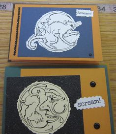 Hollween cat and moon cards with Rome's hand drawn drawings on them