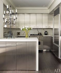 The kitchen of designer David Kleinberg's Manhattan apartment features stainless-steel cabinets offset by Calacatta gold marble counters. Diy Kitchen, Kitchen Dining, Kitchen Decor, Awesome Kitchen, Kitchen Ideas, Kitchen Grey, Space Kitchen, Compact Kitchen, Kitchen Images