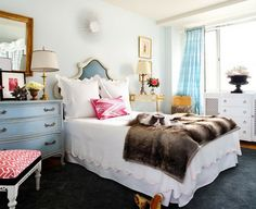 dark grey carpet + white bedroom with pink + turquoise + gold + brown accents