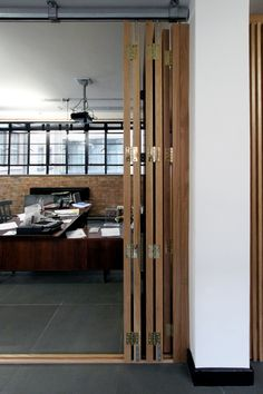 Main office floor-to-ceiling concertina sliding doors to separate director's office and meeting room