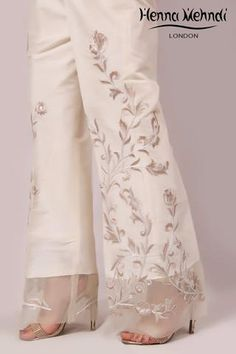 Ivory raw silk trousers with embroidery. Please note delivery time is approximately weeks. There is no exchange or refu Salwar Designs, Kurti Designs Party Wear, Blouse Designs, Pakistani Dresses, Indian Dresses, Fashion Pants, Fashion Outfits, Womens Fashion, Suits For Women