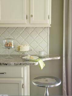 love the way they finished off this counter with a curve beyond the backsplash! it softens the the look so much!