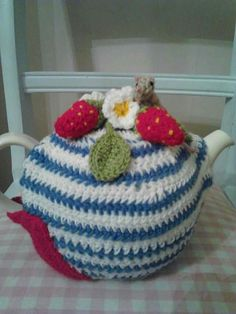 Crochet teapot cozy with strswberries and a mouse made by suzanne bunn
