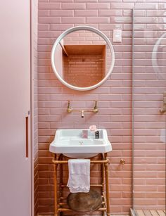 Fabiana Zanin pink Wes Anderson inspired bathroom with subway tiles and brass copper exposed plumbing | NONAGON.style