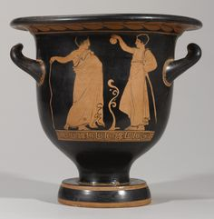 An Apulian Red-figured Bell Krater, attributed to the Tarporley Painter, circa 410-390 B.C. | two himation-clad youths on the reverse, one holding a staff, the other holding up an aryballos.
