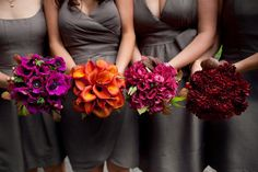 I really like the bright color of the flowers against the grey dresses