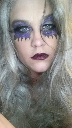 Halloween Look: Using: Sweet Libertine mineral shadows: Fiasco & After Midnight on lid/crease. SLC Glitter Shadows: Maximum Overdrive & Wicked Scepter on eyes and Dirty Girl over black lipstick.  Wet n Wild Fantasy Maker Stencils were used for mask effect.