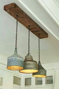 Galvanized containers as light fixture. Would look great in a farmhouse kitchen.