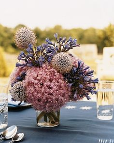 Fireworks Display Punctuate your table with arrangements that conjure stunning fireworks: Featured here are agapanthus, allium, and globe thistle