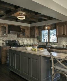 This custom kitchen brings rustic style to a new level of sophistication. Some of the beautiful features include knotty alder inset cabinets, custom grey painted island, hammered copper farm sink and custom hood. Refacing Kitchen Cabinets, Custom Kitchen Cabinets, Painting Kitchen Cabinets, Inset Cabinets, Grey Cabinets, Rustic Wood Cabinets, Walnut Cabinets, Kitchen Cupboards, Knotty Alder Kitchen