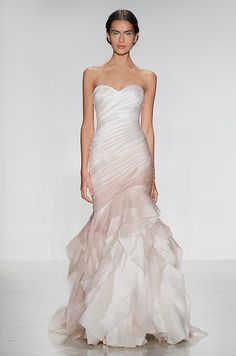 A gorgeous ombre mermaid wedding dress from the Kelly Faetanini Fall 2014 bridal collection features a stunning ruffled ...