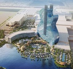 """Florida's Seminole Hard Rock Hotel & Casino has started building an addition shaped like the body of a guitar. When completed in 2020, the 450-foot-tall structure will be the largest guitar-like building in the world. The $1.5 billion construction project kicked off with a """"guitar smashing"""" ceremony characteristic of large Hard Rock events. The giant guitar building will contain 638 hotel rooms and suites in addition to a 41,000-square-foot spa, and several restaurants. The new buildings…"""
