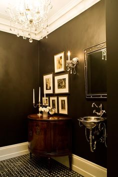 All-Out-Glam Bathroom    Sparkling fixtures brighten up dramatic walls.    A wall-mounted sink with exposed plumbing and footed antique demi-lune are a traditional alternative to a boxy modern vanity —
