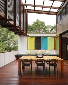 """Mooloomba House was designed by Lockyer Architects and it is located on Stradbroke Island, in Queensland, Australia. The home is spacious and fun, with colorful accents strewn all throughout the space. Mooloomba House by Shaun Lockyer Architects: """"This house is about the idea of the organic evolution of the Straddie Shack but in a contemporary vernacular. The house consists of a series of pavilions around an east facing courtyard, each with a distinct function and character..."""