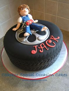 Cute for 16th Birthday Cake. Dude sitting on the wheel of a car. Made in AUstralia - Brisbane