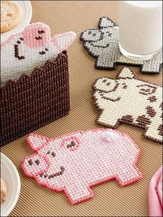 Pigs in a Poke Plastic Canvas Pattern Download from e-PatternsCentral.com -- Four friendly porkers will happily protect your tabletops.