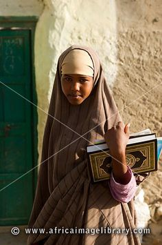 in Somali we have to go school to learning about the holy quran at  the age of 4 or 5 yrs until we finish the book and memorize the holy  book of Islam.