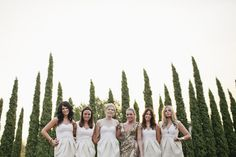 bridesmaids in white and bride in gold sequins
