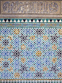size: Photographic Print: Detail of Tiles and Plaster Carving at Alcazar Royal Palaces, Seville by Krista Rossow : Outdoor Living Patios, Rustic French Country, Building A Deck, Royal Palace, Mosaic Glass, Stained Glass, Seville, Plaster, Palaces