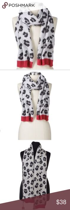 Juicy Couture Gray Leopard Muffler Scarf NWT Let out your wild side this winter wearing this Juicy Couture leopard jacquard muffler scarf in white, gray and a pink border.   FEATURES: Ribbed solid trim Jacquard fabric Fabric & Care Acrylic Hand wash 9'' wide x 30'' long Juicy Couture Accessories Scarves & Wraps