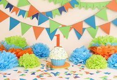 Orange, blue, and green smash cake, by MadHouse Bakes