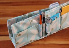 How to sew your own DIY Purse Organizer with simple laminated fabric and an old cereal box! Get your slouchy purses in order in a few easy steps!