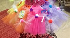 This listing is for the tutu only! No top included in this listing. Our Candy shoppe tutu has been created for tons of sweet party FUN! Perfect for Candy Land and Candy Shoppe Parties! Our Sweet Tutu is also available WITH the T-shirt in a separate listing or as a 1 piece dress