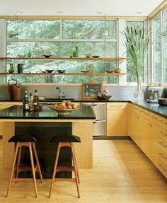 Kitchen - Spacious with shelves built in front of wrap around windows