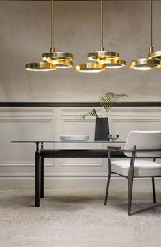 With three intersecting brass discs hung from a single drop rod, the Triarc Chandelier makes a dramatic impression. Grouped together with two or more pendants i