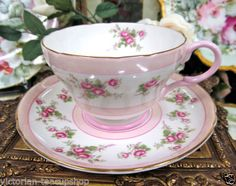 SHELLEY-TEA-CUP-AND-SAUCER-PRETTY-IN-PINK-WITH-PINK-ROSES-IN-A-CHINTZ-PATTERN