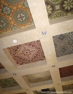 Assorted tiles with SkimStone and Modello® stencil treatments applied to Roclon Canvas and wallpaper pasted to a coffered ceiling in our Royal Design Studio. http://www.modellocustomstencils.com/