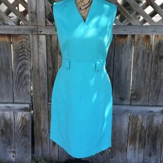Tahari aqua dress size 8 FINAL PRICE In good used condition. Pretty aqua color looks so flattering on. Measures 38 inches from top of shoulder to hem. Beautiful dress just some pulls in the thread Tahari Dresses