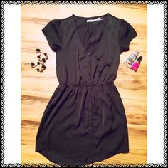 Kimchi Blue Button Down Black Dress Beautiful button down dress with flattering elastic waistband and front pockets.  Excellent preloved condition.  100% polyester.  Hand wash cold. Urban Outfitters Dresses Midi