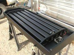 Solar Heat Exchanger design using aluminum cans stuffed in gutter downspouts.