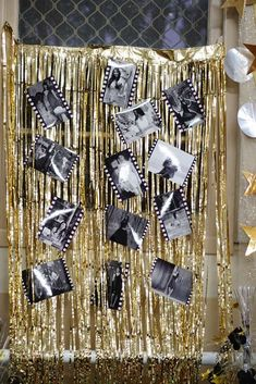 Decorate for your next Hollywood-themed party with gold streamers and black and white photos